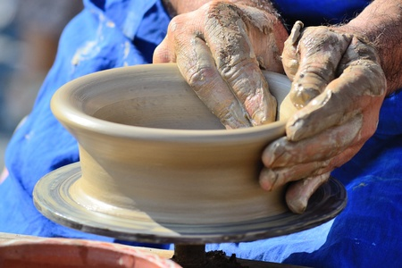 sculpting: Hands Making Pottery On A Wheel Stock Photo