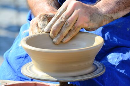 Hands Making Pottery On A Wheel photo