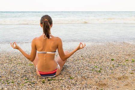 Young Girl Meditating On The Beach Stock Photo - 18664885