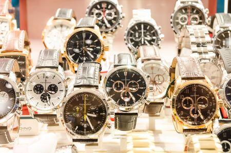 wristwatch: Very Expensive Luxurious Watches In A Store Stand
