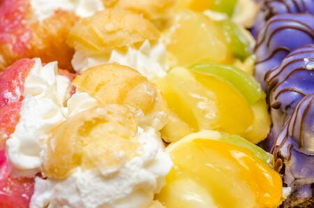 Multicolored Cookies With Whip Cream And Fruits Stock Photo - 18762445