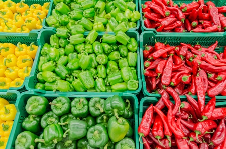 Colorful Display Of Capsicum In A Market photo