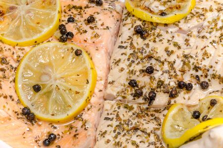 Fish Grill With Condiments And Lemons  Salmon On The Left And Carp On The Right Stock Photo - 18762637
