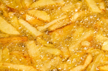 Frying French Fries In Boiling Oil Stock Photo - 18762567