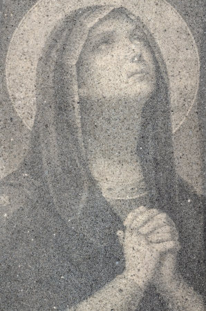 Icon Of Virgin Mary Praying Made Of Small Sand Stones photo