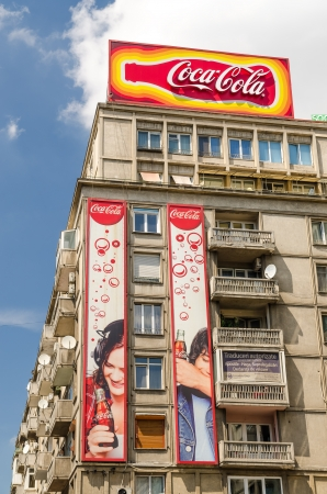 carbonated: BUCHAREST, ROMANIA - MAY 16: Coca-Cola advertising on May 16, 2013 in Bucharest, Romania. It  is a carbonated soft drink sold in stores and restaurants in every country except Cuba and North Korea.