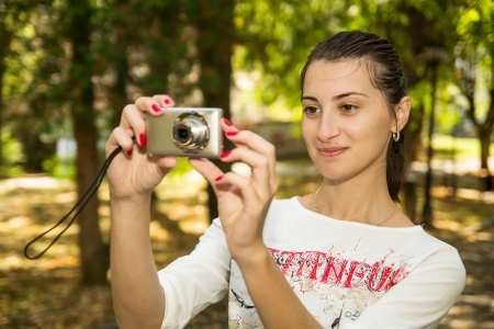 Tourist Girl with a camera Stock Photo