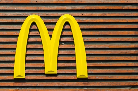 BUCHAREST, ROMANIA - JUNE 14: McDonald Sign on June 14, 2013 in Bucharest, Romania. McDonald Corporation is the world largest food chain.