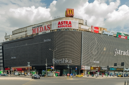 enlarged: BUCHAREST, ROMANIA - JUNE 15: Unirea Shopping Center on June 15, 2013 in Bucharest, Romania. Opened in 1976 and enlarged in 1989, it was the largest department store in Communist Romania.