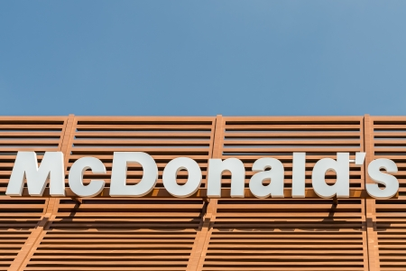 macdonald: BUCHAREST, ROMANIA - JUNE 16: McDonalds Sign on June 16, 2013 in Bucharest, Romania. McDonalds Corporation is the world largest chain of fast food restaurants. Editorial