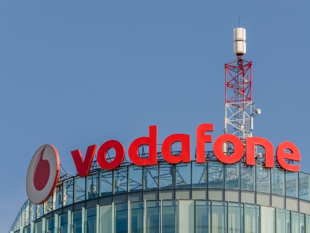 headquartered: BUCHAREST, ROMANIA - JUNE 24: Vodafone Building on June 24, 2013 in Bucharest, Romania. It is the worlds second-largest mobile telecommunications company headquartered in London.