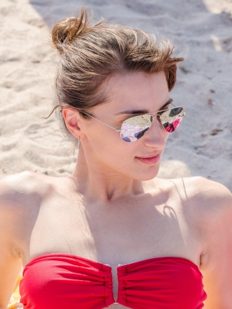 Portrait Of Girl On Beach Getting Tanned Stock Photo - 21687894