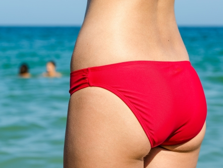 Girl With Beautiful Slim Body On Beach With Ocean Background Stock Photo - 21687933