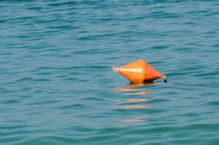 Orange Life Buoy In Ocean Close Up photo