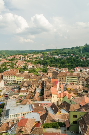 SIGHISOARA, ROMANIA - AUGUST 23  Sighisoara Medieval Fortress Aerial View on August 23, 2013 in Sighisoara, Romania  Founded in 1191, today is the most well preserved inhabited citadel in Europe