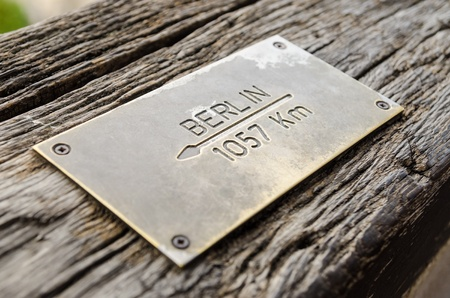 Distance Sign On Wood To Berlin City photo