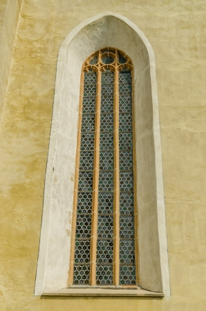 Vintage Window Of An Old Evangelical Church In Gothic Style photo