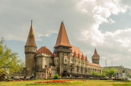 HUNEDOARA, ROMANIA - AUGUST 25  Corvin Castle on August 25, 2013 in Hunedoara, Romania  It is a Gothic castle built in 1446, has tall and strong defence towers, an interior yard and a drawbridge