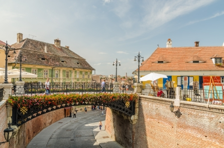 SIBIU, ROMANIA - AUGUST 27  The Bridge Of Lies on August 27, 2013 in Sibiu, Romania  Built in 1859 the oldest cast iron bridge it is a metal bridge that connects the Small Square with Huet Square