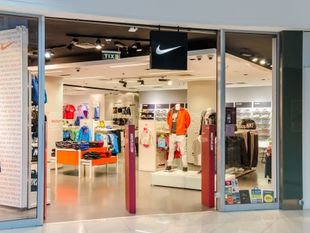 suppliers: BUCHAREST, ROMANIA - OCTOBER 09  Nike store on October 09, 2013 in Bucharest, Romania  It is one of the world s largest suppliers of athletic shoes and a major manufacturer of sports equipment
