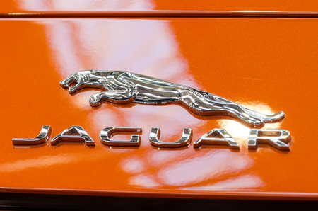 headquartered: BUCHAREST, ROMANIA - OCTOBER 11  Jaguar Sign on October 11, 2013 in Bucharest, Romania  Founded in 1922 it is a British multinational luxury car manufacturer headquartered in Coventry, England  Editorial