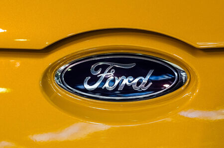 automaker: BUCHAREST, ROMANIA - OCTOBER 11  Ford Sign on October 11, 2013 in Bucharest, Romania  Ford Motor Company is an American multinational automaker headquartered in Dearborn, Michigan incorporated in 1903