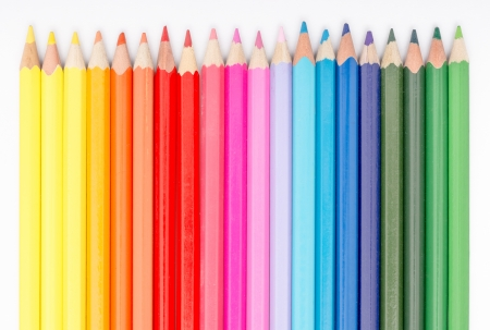 Close Up Of Coloring Crayons Arranged In Rainbow Line photo