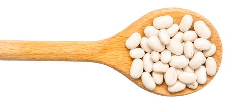 Wooden Spoon With White Beans Isolated photo