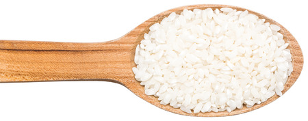 Wooden Spoon With Rice Seeds photo
