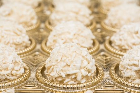 Box Of Candies With White Chocolate And Coconut photo