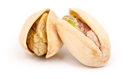 Pistachio Nuts On White Background photo
