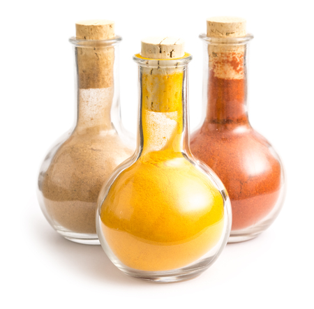 Bottles With Indian Spices Turmeric, Biryani And Kashmiri Isolated On White photo