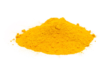 Indian Spices Of Turmeric Powder Pile On White Background photo