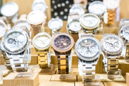 BUCHAREST, ROMANIA - DECEMBER 29, 2013  Fossil Watches In Shop Window Display  Founded in 1984 it is an American designer and manufacturer of clothing and accessories, primarily watches and jewelry