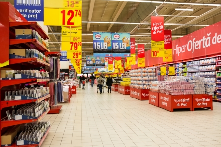 aisles: BUCHAREST, ROMANIA - JANUARY 22, 2014  People Shopping In Supermarket  The supermarket is a self-service shop offering a wide variety of food and household products, organized into aisles