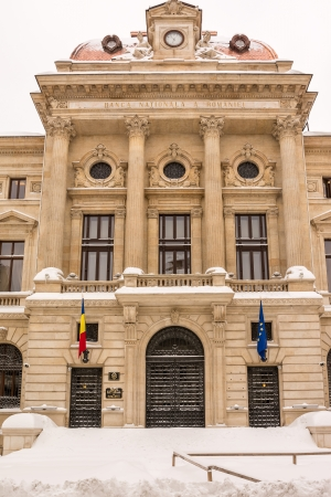 BUCHAREST, ROMANIA - JANUARY 27  First Snow On The National Bank Of Romania facade on January 27, 2014 in Bucharest, Romania  It Is Located In The Old Center On Lipscani Street And Was Founded In 1880 Stock Photo - 25387005