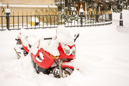 snowed: Red Motorcycle Covered In Winter Snow