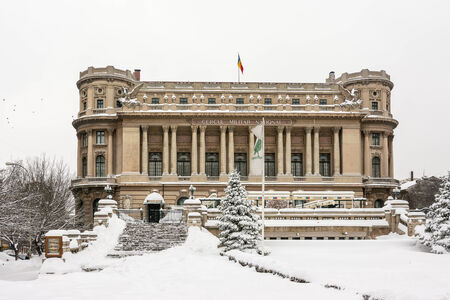 neoclassic: BUCHAREST, ROMANIA - JANUARY 27  First Snow Over National Military Circle on January 27, 2014 in Bucharest, Romania  It was built in 1912 by architect Dimitrie Maimarolu, in French neoclassic style