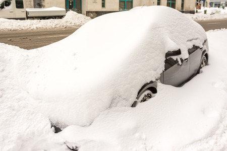 Car Covered In Fresh White Snow photo