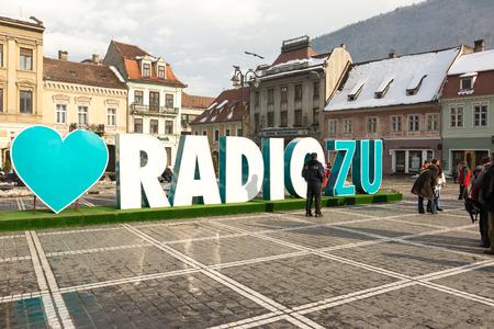 fm: BRASOV, ROMANIA - FEBRUARY 09  Radio Zu Advertising on February 09, 2014 in Brasov, Romania  Started in 2008, Radio Zu is one of the first three listened radio stations in Romania