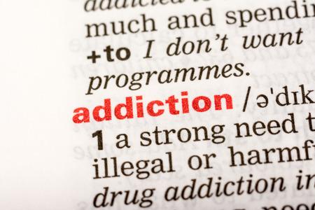 辞書で単語の定義を中毒をクローズ アップ 写真素材