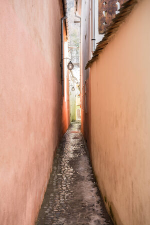 String Street  Strada Sforii  is the narrowest street in the city of Brasov, Romania  It is believed to be one of the narrowest streets in Europe and was built in the XVII century  photo