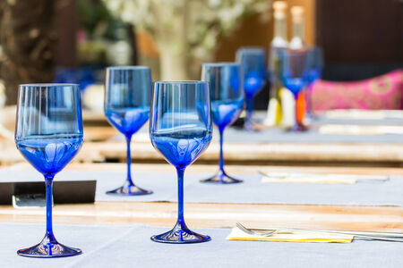 Elegant Empty Blue Glasses On Restaurant Table