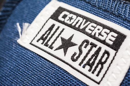 converse: BUCHAREST, ROMANIA - MARCH 16, 2014  All Star Converse Sign On Retro Converse Sneakers  Founded in 1908 is an American lifestyle company with a production output of shoes and lifestyle fashion
