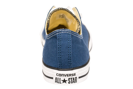 BUCHAREST, ROMANIA - MARCH 18, 2014  All Star Converse Sneakers Isolated On White  Founded in 1908 is an American lifestyle company with a production output of shoes and lifestyle fashion