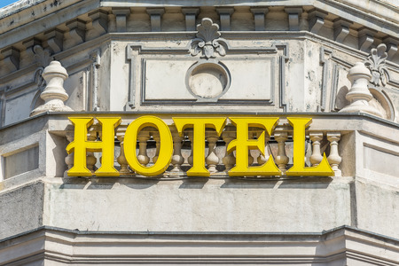 hotel sign: Retro Hotel Sign Close Up On Building Stock Photo