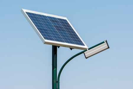 Modern Public Light Post Powered By Solar Energy photo