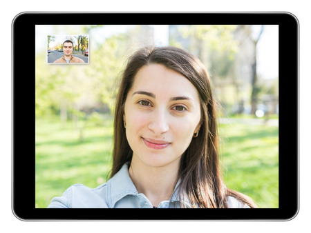 Pretty Young Girl Video Call On Modern Black Tablet With Young Man photo