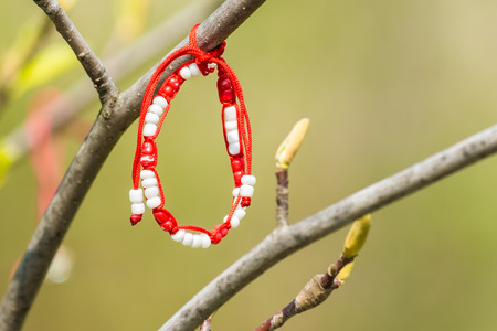 Red And White Martisor Decoration Hanging On A Tree. Martisor is an old Romanian celebration at the beginning of spring on March the 1st Symbolically it is correlated to women and to fertility