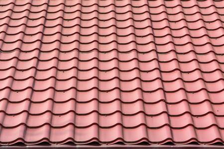asphalt shingles: House Shingles Tiles On A Roof Closeup Stock Photo